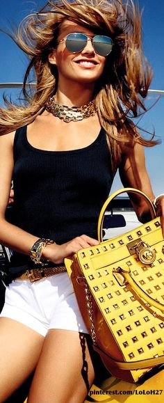 Michael Kors love the punch of color the bag could add to a simple outfit!