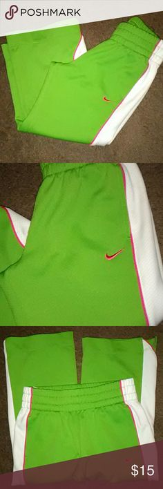 Nike Green And Pink Pants So cute , like new, daughter wore them one time and they didn't even fit her when she did wear them, no wear to the bottom, pockets, bright nice pants Tag reads medium Fits a 6/6x Ships quick Smoke free home Check out my other kids items Nike Bottoms Sweatpants & Joggers