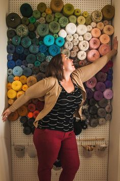 Yarn wall: display & organize the stash with peg board. Did this in my craft room after seeing this photo, and it is the BEST THING EVER!!!