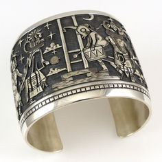 Bennet Kagenveama cuff.  Wide Sterling Silver Cuff Bracelet with Intricate Hopi Overlay Designs. From left to right, this cuff features a Red Tail Hawk, Velvet Shirt Kachina, Mudhead Dr