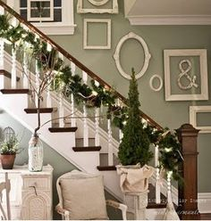 Gorgeous garland and tree. Also loving the empty frames!
