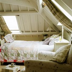 A clever installation of curtains using rods on the top and bottom of this charming angled ceiling!
