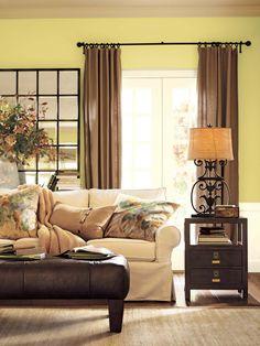 benjamin moore green living room - light beige-green walls, light sofa, dark wood, darker curtains
