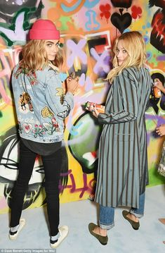 Cara Delevingne and Margot Robbie work on Suicide Squad graffiti mural