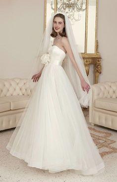 Classic strapless ballgown wedding dress with flower cinched waist detail; Featured Dress: Atelier Emé