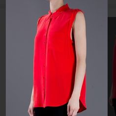 Equipment Sleeveless Silk Blouse Feminine and casual elegance with Equipment! Wonderful soft loose fitted silk blouse in bright red and longer cut with one front pocket, rounded hemline, button facing, shoulder latches and wide rolled-up sleeve cuffs. The timeless piece lightens up your spring wardrobe - always chic with straight and clean pants and pumps! Katie Holmes loves the look ... 100% silk. True to size. Dry clean. Extra long cut. Straight cut. Breast pockets. Top is in good…