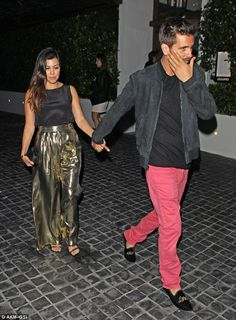 http://news-all-the-time.com/2014/04/11/kourtney-kardashian-steps-out-in-very-bold-trousers-as-she-dines-in-la-with-scott-disick/ - Kourtney Kardashian steps out in VERY bold trousers as she dines in LA with Scott Disick  - By Daily Mail Reporter  As reality TV stars, they are probably accustomed to looking their best when stepping out into the real world. But Kourtney Kardashian and her long-term partner, Scott Disick, suffered something of a fashion fail when they dined o