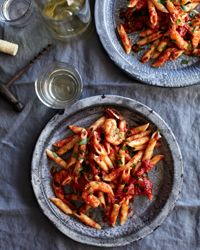 Penne with Shrimp and Spicy Tomato Sauce Recipe from Food & Wine...Suggested Pairing:  With its competing spices, strong-flavored cilantro, and acidic tomatoes, this pasta dish calls for a simple Italian white—a Pinot Grigio, for example.