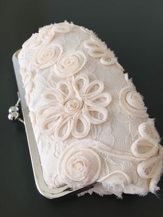A personal favorite from my Etsy shop https://www.etsy.com/listing/245049661/ivory-chiffon-lace-clutch