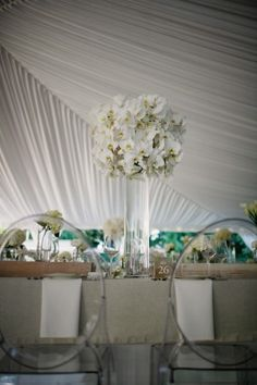 lucite chairs paired with tables that weren't overly modern - good mix