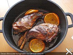 Portugiesisches Kaninchen mit Orangen