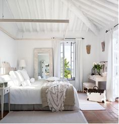 Beautiful white bedroom with high ceilings and lots of natural light | Friday Favorites at www.andersonandgrant.com (This links to Tumblr...please let me know if you know the original source, please!)