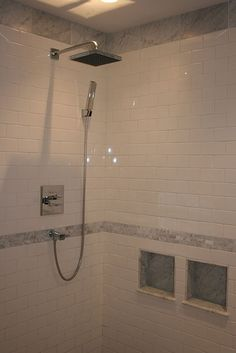 love this shower's mix of subway and carrara.  affordable + luxury