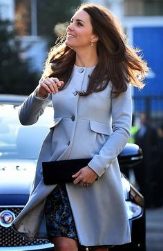 Catherine, Duchess of Cambridge arrived for a morning of engagements wearing a baby blue cashmere coat