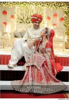 Bridal in red long shirt with lehnga and groom in white sherwani with red turban latest indian and pakistani wedding matching dress combinations for bride and groom 2017