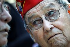 Frank G. Willetto, an 84-year-old Navajo Code Talker, reflects on World War II with a fellow veteran at a ceremony commemorating the 65th an...