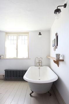Traditional roll top grey bathtub with feet