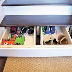 Two drawer boxes fit between the stair stringers, and the stair riser acts as the drawer front. When the drawer is closed, you wouldn't know it's there.