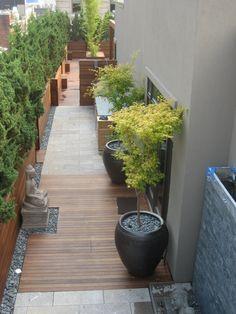 Tarima, acolchados y macetas. City Beautiful Carpentry: Deck