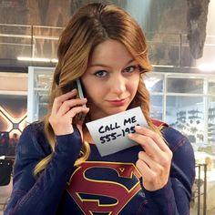 Supergirl (Melissa Benoist) gives out her number.