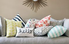 These patterned pillows give a fun look to this room and are a nice burst of colour against the grey walls.