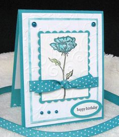 Stamper:  pam124 I really LOVED the textures of all the embossing on Jdmommy's card. I kept the basic layout, but changed the color combo to Bermuda Bay and White, used a different flower image, different efs and added some pearls and glitter. Other than that, I stayed pretty true to her card.   Anne's card was pretty and soft and I chose to make mine a more vibrant version.