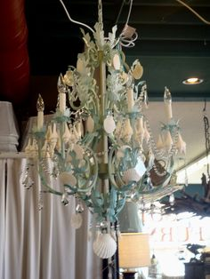 The perfect chandelier for a beach cottage - right color, right motif, and fancy!