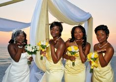 Yellow  white bridal party with the bamboo canopy decorated in white and yellow fabrics