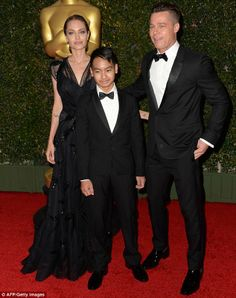 That's our boy: Proud parents Angelina Jolie, Brad Pitt and their son Maddox at the Governors Awards, presented by the Academy of Motion Pic...