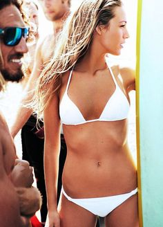 Blake Lively wears a plain white string bikini in Vogue, June 2010, photographed by Mario Testino