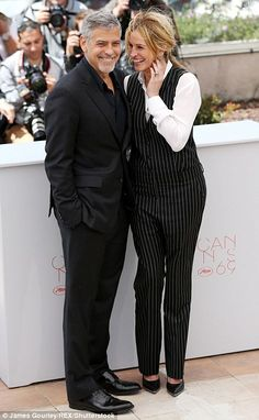 Reunited and it feels so good: They became firm friends after starring in the Ocean's Eleven series together. So Julia Roberts and George Clooney were able to let loose and mess around together as they posed for photographs at the Cannes Film Festival on Thursday