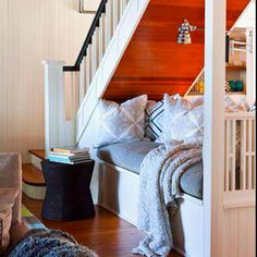 Awesome under-stairs storage and reading nook! So cute.