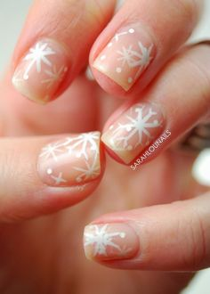 A very cute snowflake inspired nude nail art design. Give your nude nail art the winter breeze by adding pretty snowflake designs on top it in white polish.