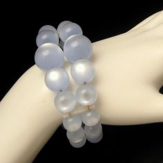 PRETTY BLUE LUCITE MOONGLOW! A fabulous vintage 1950s to 1960s flexible coiled cuff bracelet with chunky pale blue Lucite moonglow beads. So mod! See All the Beautiful Vintage Bracelets in My Shop: https://www.etsy.com/shop/MyClassicJewelry?section_id=13113944