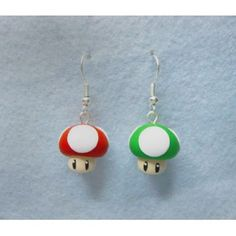 Earrings inspired in mushrooms that Mario use for to take a life and others of Super Mario Bros. game, completely handmade and the composition is polymer clay Weird Jewelry, Funky Jewelry, Cute Jewelry, Handmade Jewelry, Diy Clay Earrings, Cute Earrings, Diy Indie Earrings, Polymer Clay Charms, Polymer Clay Jewelry