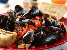 Shuckers' Portuguese Mussels recipe from Diners, Drive-Ins and Dives via Food Network