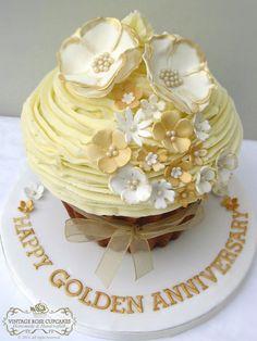 Golden wedding anniversary giant cupcake Large Cupcake Cakes, Big Cupcake, Big Cakes, Giant Cupcakes, Wedding Cakes With Cupcakes, Yummy Cupcakes, Fancy Cakes, Golden Anniversary Cake, Wedding Anniversary Cakes