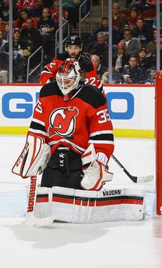 NEWARK, NJ - DECEMBER 27: Cory Schneider #35 of the New Jersey Devils makes a chest save against the Pittsburgh Penguins during the game at Prudential Center on December 27, 2016 in Newark, New Jersey. (Photo by Andy Marlin/NHLI via Getty Images)