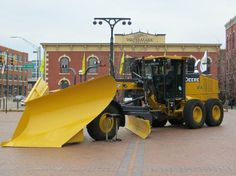 The John Deere Pavilion in Moline, Ill. Heavy Construction Equipment, Heavy Equipment, Construction Machines, Snow Removal Equipment, Illinois, Earth Moving Equipment, Attraction, John Deere Equipment, Tire Pressure Monitoring System