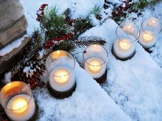 Illuminate your walkway! Guide guests to your door with simple glass votives >> http://www.diynetwork.com/decorating/10-unique-ways-to-decorate-your-front-door-for-the-holidays/pictures/index.html?soc=hpp#