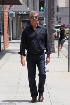Double 0 heaven: He's most famous for playing secret agent James Bond and Pierce Brosnan was still channelling his alter ego as he headed out in Beverly Hills on Wednesday