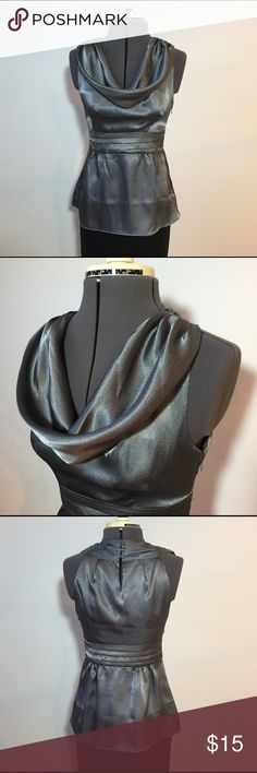 """BR Factory Silver Drape Neck Blouse Banana Republic Factory Silver Drape Neck Blouse. In great condition. Size 0 Petite measures: 12"""" across shoulders, 15"""" across chest, 13"""" across waist, 24"""" long. 100% poly with no stretch. Has side zip closure with 3 buttons at neck. 930/100/1027 Banana Republic Tops Blouses"""