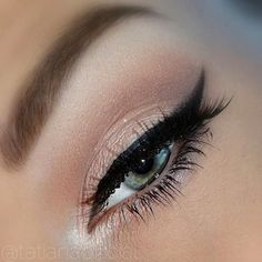 Beautiful crisp wing and soft pink eye look.
