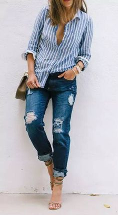 Aimee Song of Song of Style wears a striped button-down top, distressed boyfriend  jeans, strappy neutral sandals and mixed metals 6286d10378