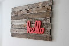 Cute simple wall sign. They used a scroll saw to cut the word out.