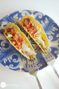 Use a fork to keep taco shells steady while filling them up. (I'd like to shake the hand of the person who thought this one up!)