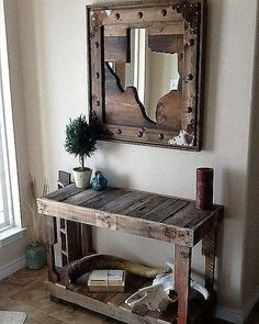 Check out this reclaimed pallet wood mirror frame customised with decorative studs. We've got a wide variety of shapes and sizes for you to get really creative.  Doorstuds at NoWeld Ornaments