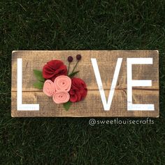 A personal favorite from my Etsy shop https://www.etsy.com/listing/467599109/love-wood-sign-with-handmade-felt