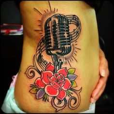 Tattoo by @vizthebeast. #music #microphone #rose #vintage