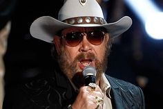 "8-8 in 1975: Hank Williams, Jr. falls 500 feet down Ajax Mountain near Missoula, MT, exposing part of his brain and keeping him in and out of hospitals for the next two years. The resultant facial scars would inspire his trademark ""hat, beard, and shades"" look."